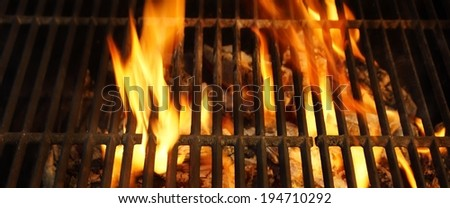 Hot BBQ Grill, Bright Flames and Burning Coals. Background and Texture with space for text or image. - stock photo