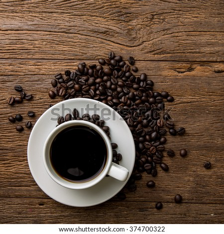 Hot  black coffee and roasted coffee beans. top view - stock photo