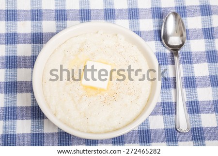 Hot bowl of grits with melting butter - stock photo