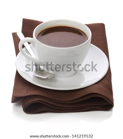 Hot c��hocolate in white cup on brawn table-napkin