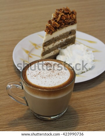 hot capuchino with almond coffee cake background - stock photo