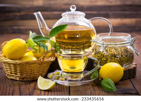 Hot chamomile tea with lemon - stock photo