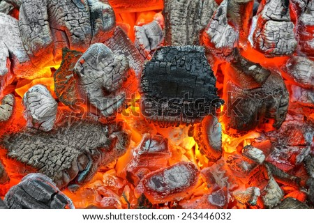 Hot Charcoal with Bright Flames in BBQ Pit - stock photo