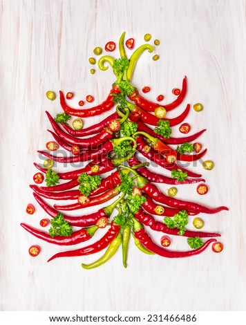 Hot chili  christmas tree on white wooden background, top view - stock photo