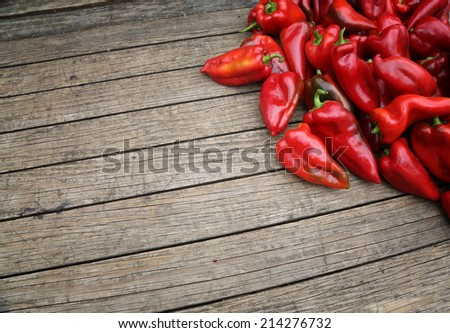 hot chili paprika on wooden table with space for your text. - stock photo