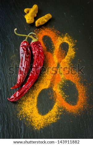 Hot chili pepper and turmeric on the chalkboard. spices - stock photo