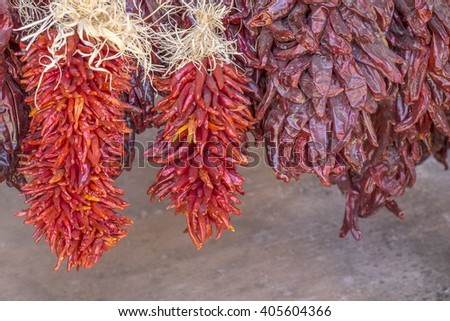 Hot Chili Peppers Hanging to Dry Outdoors - stock photo