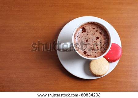 Hot chocolate and macarons in the wood table - stock photo