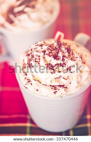Hot chocolate garnished with whipped cream and cocoa powder. - stock photo