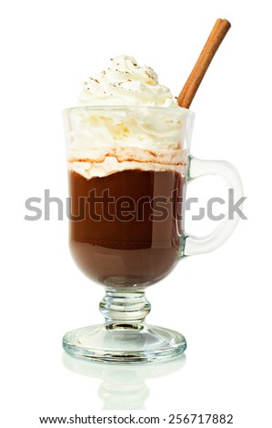 Hot chocolate in a glass with whipped cream and cinnamon isolated on white - stock photo