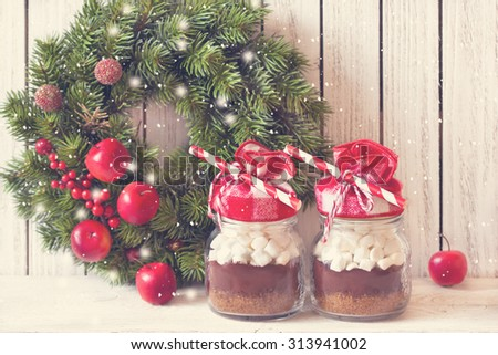 Hot chocolate mix with marshmallow for Christmas presents or cooking holiday drink. Vintage toned photo. - stock photo
