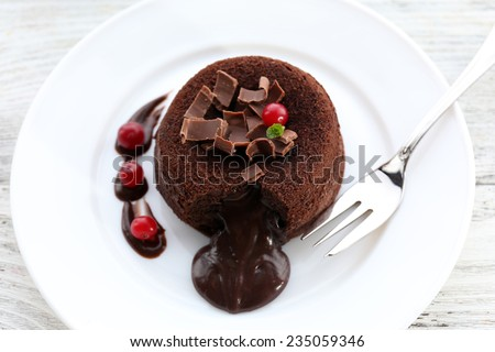 Hot chocolate pudding with fondant centre, close-up - stock photo