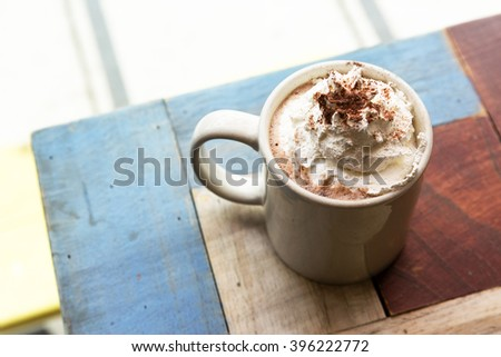 Hot chocolate topping with whipped cream - stock photo