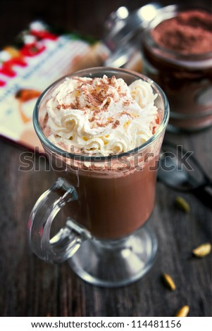 Hot chocolate with cinnamon stick in a cup - stock photo