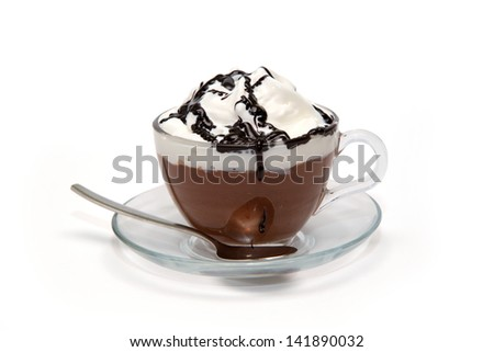 Hot chocolate with cream and syrup in glass cup - stock photo