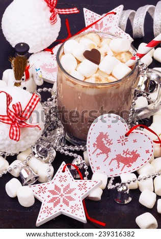 Hot chocolate with marshmallows cocoa bell love heart winter hot drink milk cocktail straw striped soft selective focus toned photo