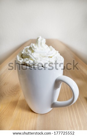 Hot chocolate with whipped cream and no chocolate sprinkles.