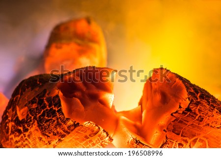 Hot coals in a wood burning stove - stock photo