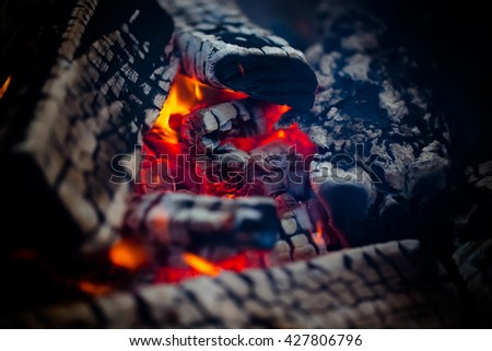 Hot coals of a bonfire. Defocused. Toned. - stock photo