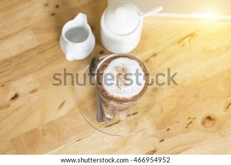 hot cocoa chocolate drink with sugar and syrup mug on wooden desk