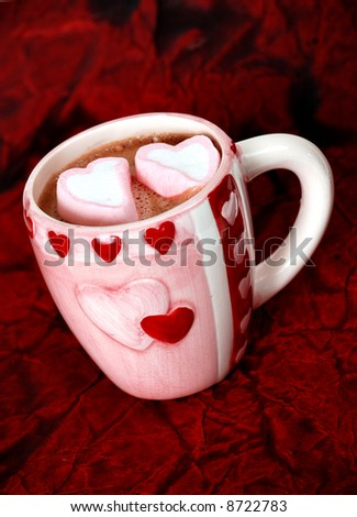 hot cocoa in a heart mug with heart-shaped marshmallows - stock photo
