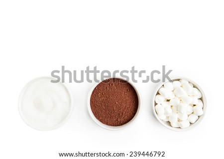 Hot Cocoa ingredients isolated on a white background in bowls. - stock photo