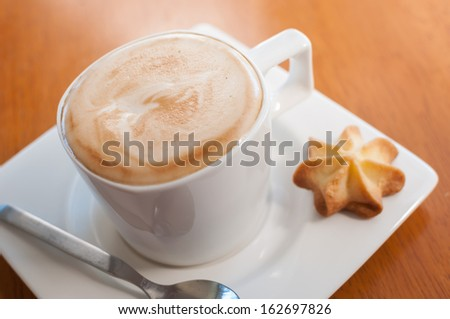 Hot coffee and cookies are great for a breakfast - stock photo