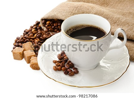 Hot coffee, coffee beans and brown sugar - stock photo