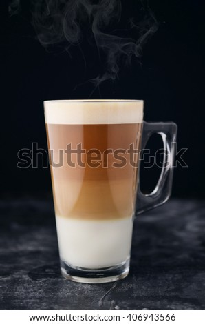 Hot coffee in glass on dark wooden background - stock photo
