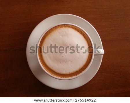 Hot coffee in white cup on wood table