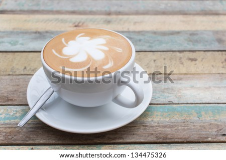 Hot coffee latte on grunge background - stock photo