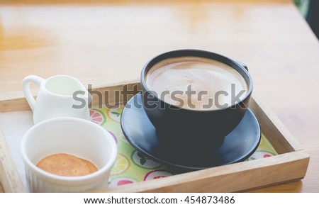 Hot coffee mocha and biscuit on the wood desk.(selective focus, vintage effect) - stock photo