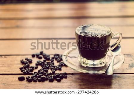 Hot coffee, mocha brown wood table top. - stock photo