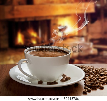 hot coffee near fireplace - stock photo
