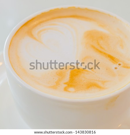 Hot coffee on white table