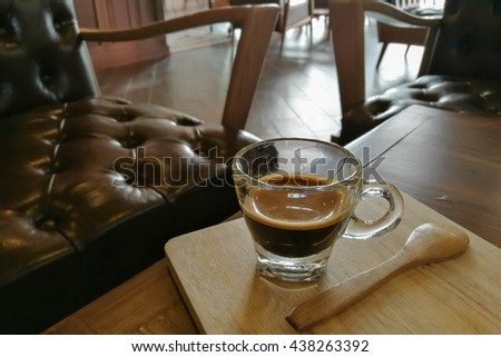 hot coffee on wooden table in coffee shop - stock photo