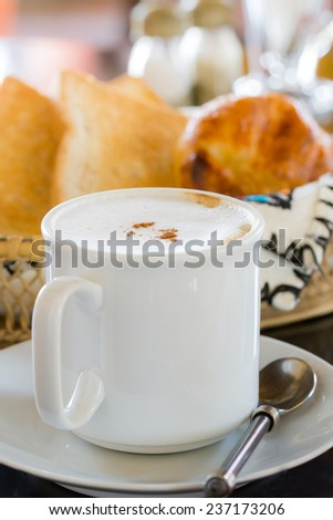 Hot Coffee with Bread in background - stock photo