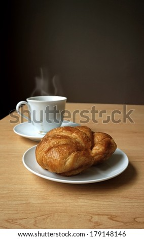 Hot coffee with croissant