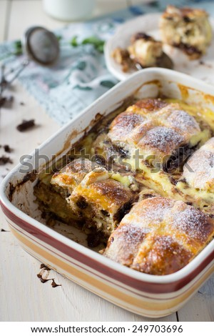 Hot cross bun pudding with chocolate and orange - stock photo