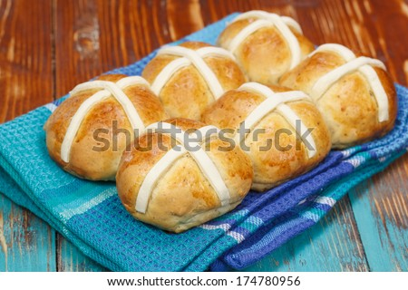 Hot cross buns. A Traditional Easter treat. Spiced, sticky glazed fruit buns with pastry crosses. Macro, selective focus - stock photo