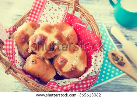 Hot Cross Buns in Basket. Easter Greeting Card. Photo  in Retro Tone Style. - stock photo