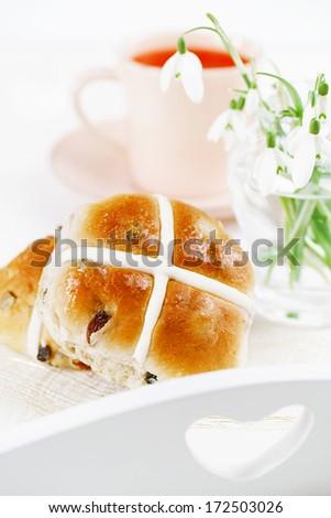 hot cross buns in wooden tray, shallow dof - stock photo