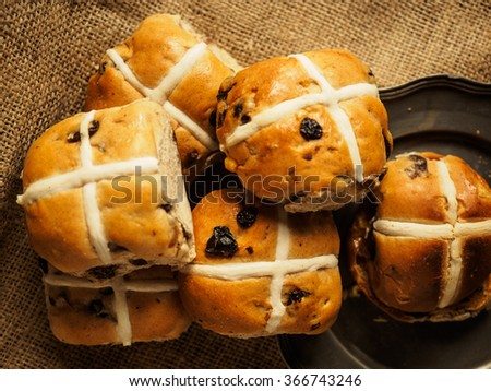 Hot cross buns on a rustic background shot from above - stock photo