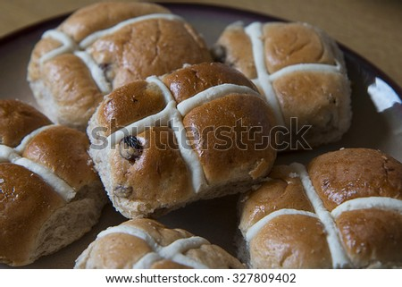 Hot Cross buns ready for toasting, buttering and traditionally eaten at Easter in the UK - stock photo