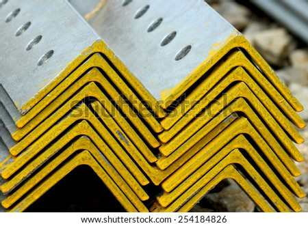 Hot-dip steel galvanized bunch on the rack in warehouse - stock photo