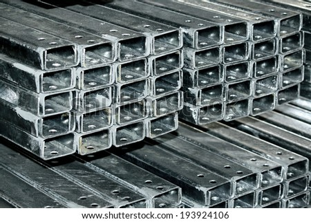 Hot-dip steel galvanized channel bunch on the rack in warehouse
