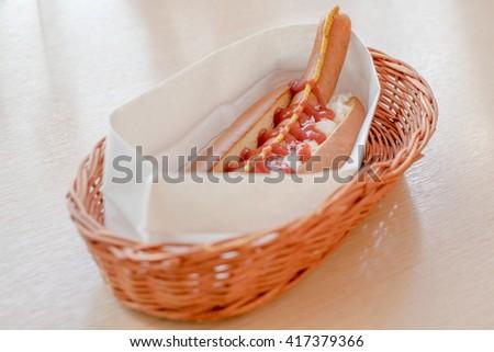 Hot dog in basket - stock photo