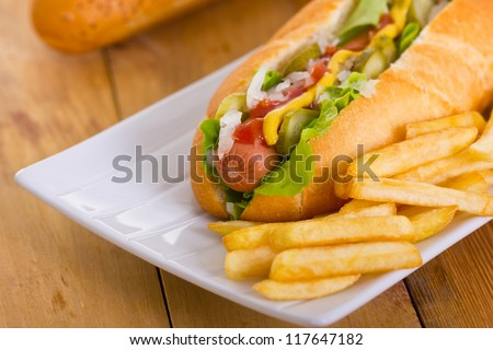 Hot dog on a plate - stock photo