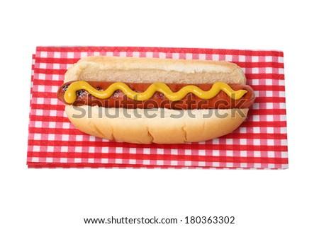 Hot dog on napkin, cutout on white background - stock photo