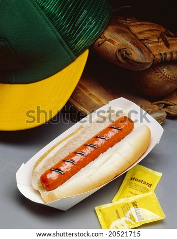 Hot Dog with baseball glove and cap - stock photo